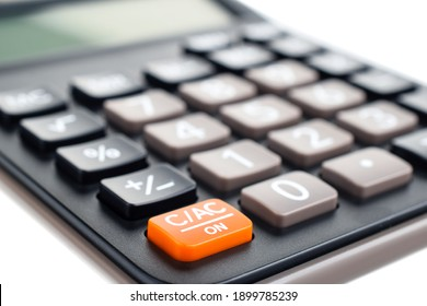 Black plastic digital calculator, isolated on a white background, close-up. Symbol economics, mathematics, accounting, finance concept. The day of knowledge, to calculate, to count money.
