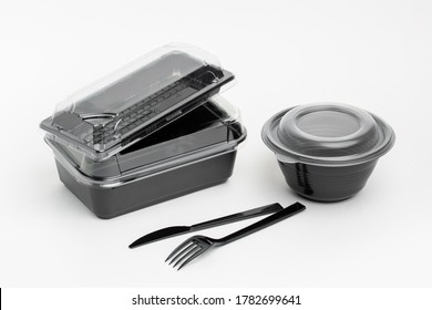Black plastic dish ware, for delivery or take away food on white background
