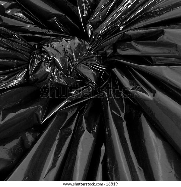 A black plastic garbage bag detail