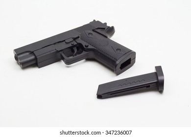 black plastic hand gun release out magazine on white background