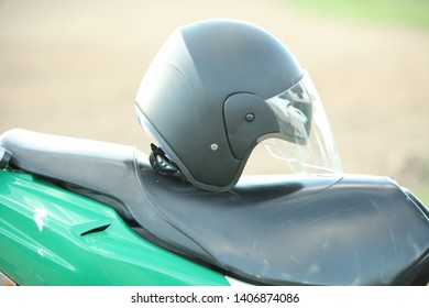 black plastic helmet on a motorcycle seat
