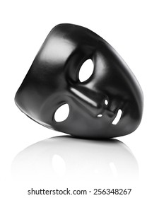 Black plastic mask isolated on white with natural reflection.