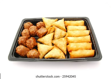 A black plastic party plate with savory food. Image isolated on white studio background.