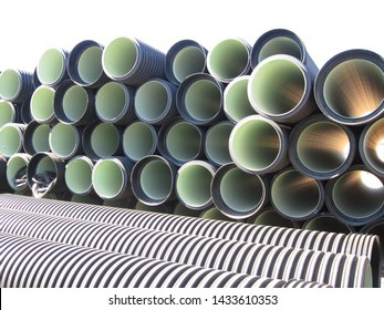 Black plastic pipes of large diameter for installation of sewerage system at a construction site