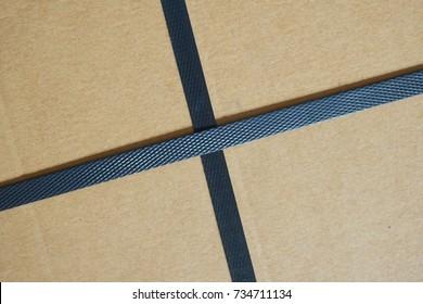 black plastic strap box in cross shape