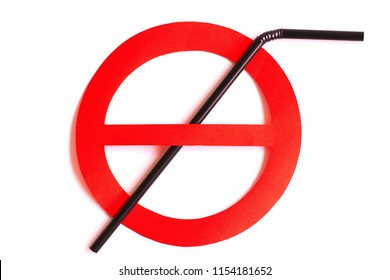Black plastic straw set up in a red prohibition circle over a white background, telling a campaign of ban on the subject for an environmental concern