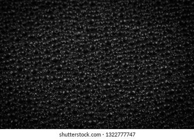 Black plastic texture background - macro photography