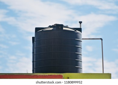 Black plastic water tanks of a house isolated unique photo