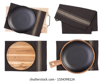 Black plates, cutting boards and napkins isolated on white background, top view