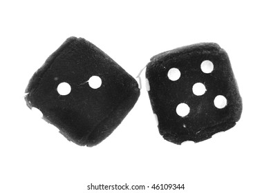 Black Plushy Dice made out of a cotton like fabric material isolated on white background.