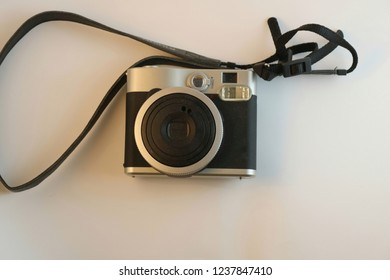 A black polaroid camera isolated on a white background