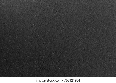 Black polystyrene foam texture for background