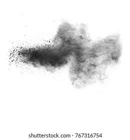 Black powder explosion on white background. Abstract black dust texture on white background.