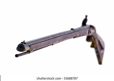 Black powder flint lock rifle with the focus on the muzzle end of the gun
