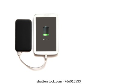 Black power bank charged white tablet