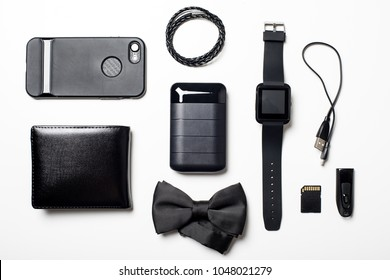 Black power bank and many black items for men. Close up at black power bank display.