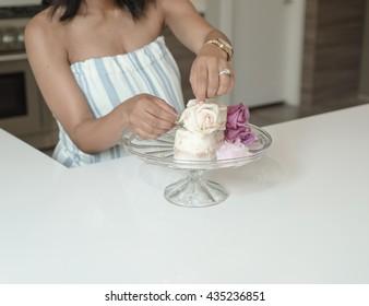 Black Pregnant Woman in Kitchen