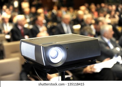 Black projector for business presentation in the foreground