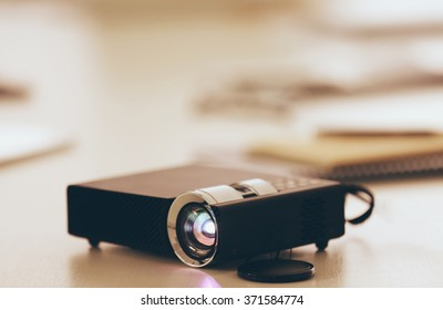 Black projector on light table, close up