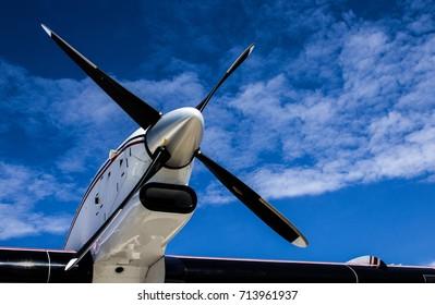 Black Propeller Against a Bright Blue Sky