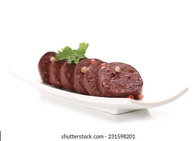 black pudding on a white background