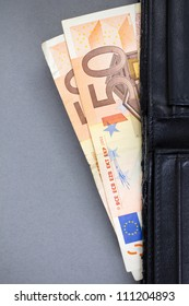 black purse in which two banknotes by a face value 50 euro