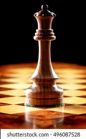 Black Queen on Chessboard