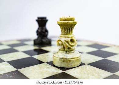 The black queen pursuing the white queen on the chessboard