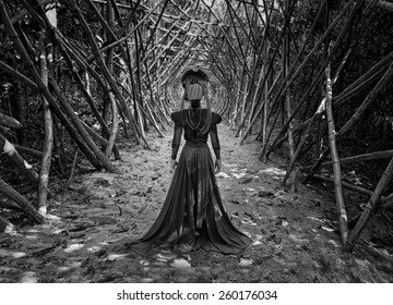 the black queen.black and white photo of the girl freak running along the corridor of the branches