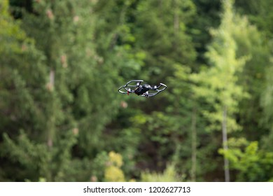 Black race drone flying trough the air