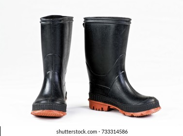 Black rain boots on white background.