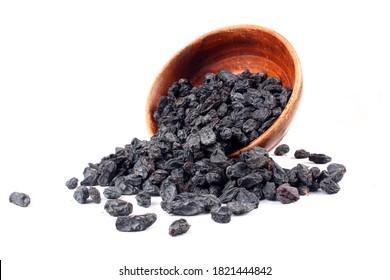 black raisins on white background.