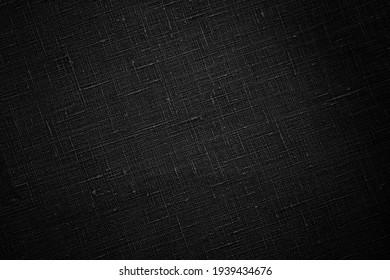 Black raw organic fabric bag pattern. Black flax texture. Pure linen sack cloth textile background.