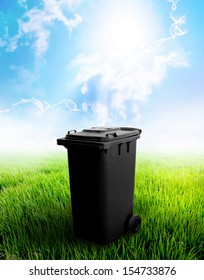 Black Recycle Bin With Landscape Background.