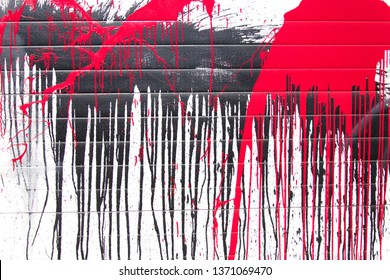 Black and red color spray paint or graffiti design element on a white background