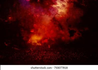 black and red glitter lights background. defocused.