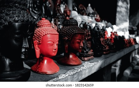 Black and Red Lord Gautama buddha sculptures
