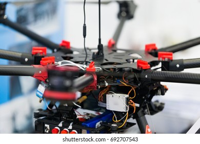 Black and red multicopter closeup. Drone with professional camera. Octocopter for filming