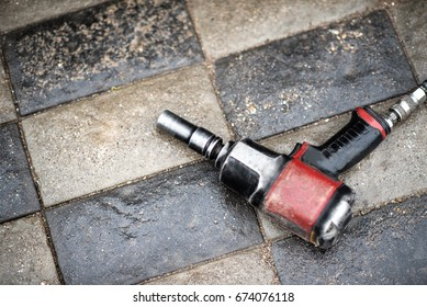 Black and Red pneumatic wrench, industrial tool.