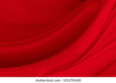 Black red satin dark fabric texture luxurious shiny that is abstract silk cloth background with patterns soft waves blur beautiful.