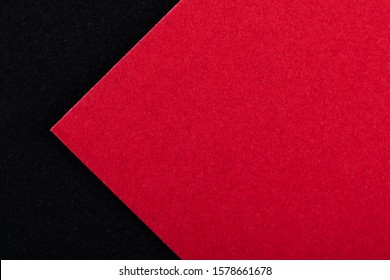 Black and red sheets of colored velvet paper. Bright color background. Horizontal orientation. Angle and diagonal lines. Top view flat lay with copy space.