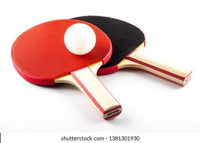 Black and red table tennis racket with white ball, isolated