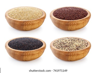 Black, red and white quinoa grains on wooden bowl. Healthy food.