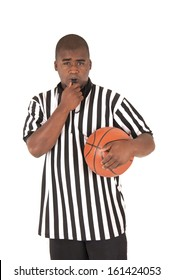 black referee blowing whistle holding a basketball