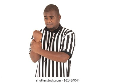 black referee making signal for holding call