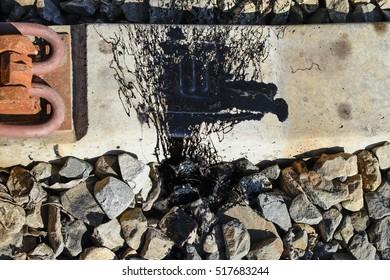Black Resin shed on the railroad ties. Tar unturned.