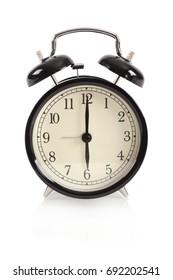 Black retro alarm clock on isolated background