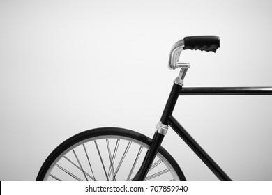 Black retro bicycle against white background