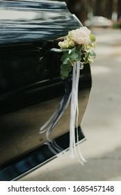 black retro car with wedding decor