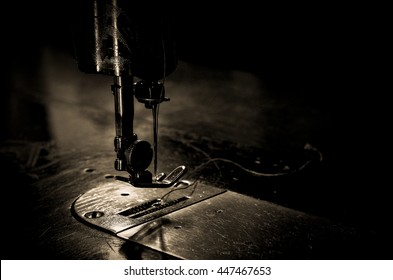 Black retro Needle and thread of an Sewing machine in an old house.tool to make the thread bobbin for and Cotton is raw for weave, tools to work natural textile.
